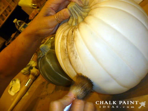 Using the dark wax on the pumpkin.