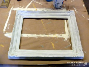 The old picture frame before painting with chalk paint.