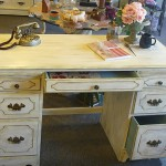 White antique desk with 7 drawers and 2 pull out trays, lovingly refinished.