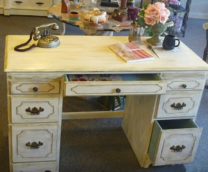 White shabby chic antique desk with duck egg blue drawers.