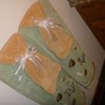 Light green towels with butterflies and gold towels for Spring decorating.