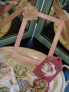 Waxed pink frame with flower.